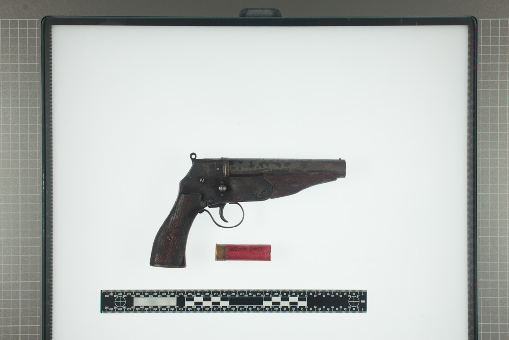 A modified gun with a shell lays on a table in the Forensic Institute of Slovenia. The gun was used to commit suicide with a shot in a head.