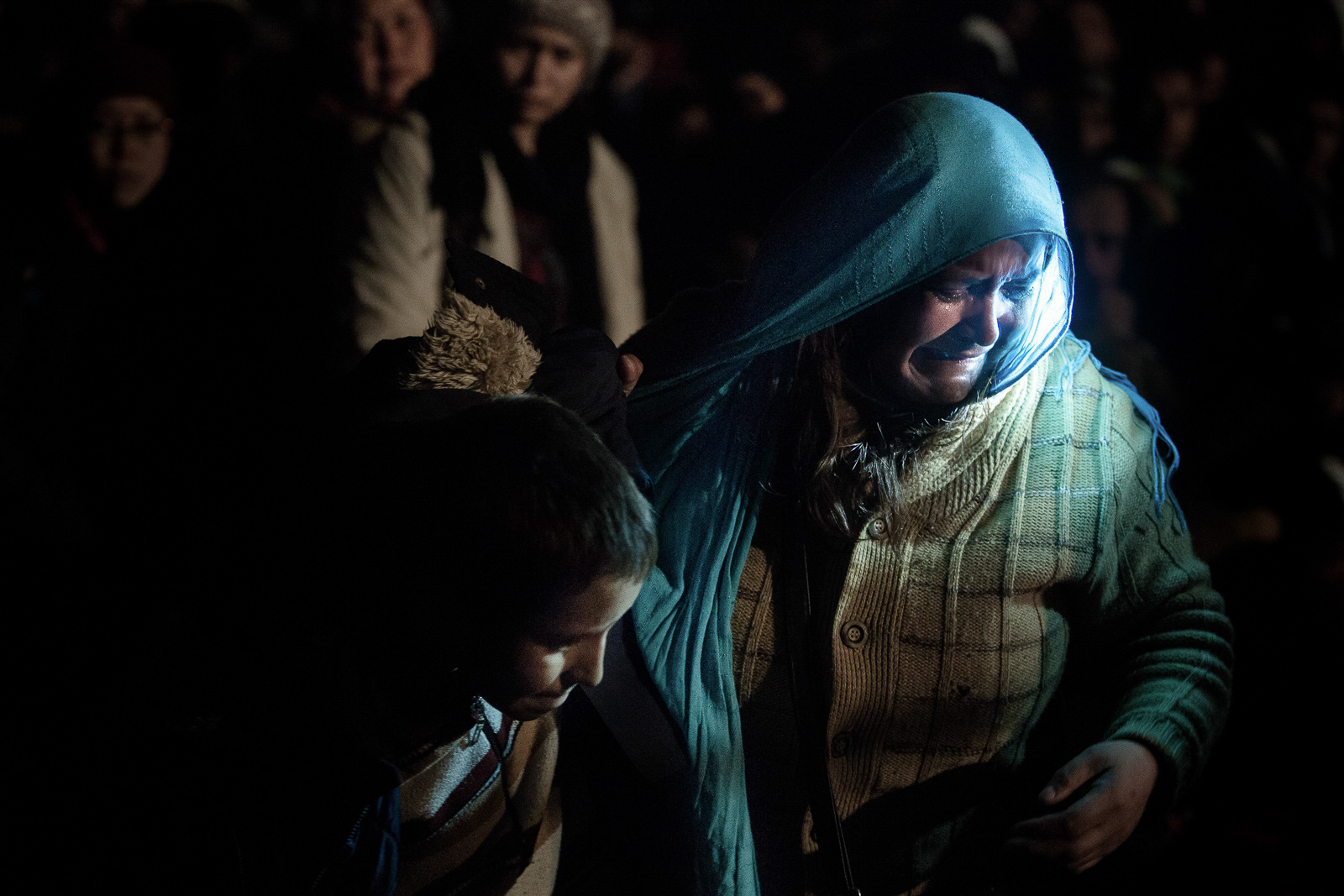 Šentilj, Slovenia - October 29, 2015: A refugee is crying in frustration after lining up for at least a whole day with her child, to cross the border with Austria in Šentilj, Slovenia on October 29, 2015.