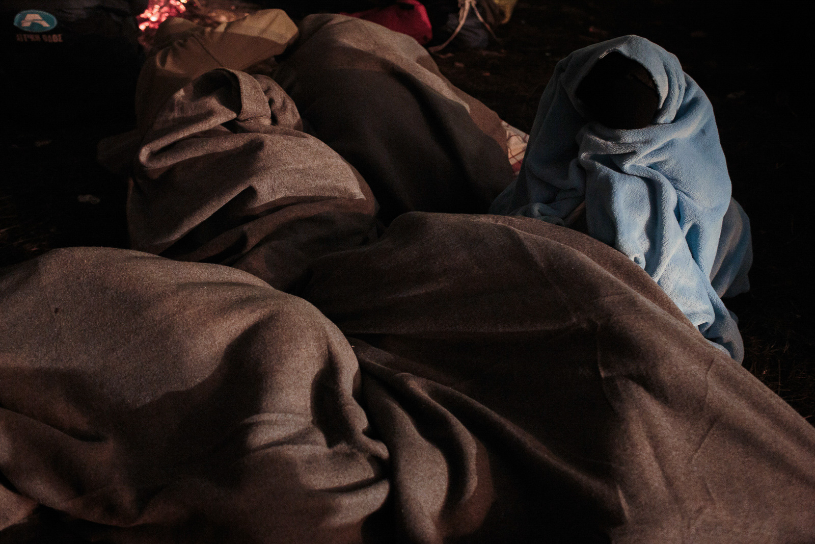 Šentilj, Slovenia - November 2, 2015: A group of refugees is sleeping as they wait to cross into Austira at Sentilj border crossing. The autumn temperatures has reached as low as one degree Celsius.