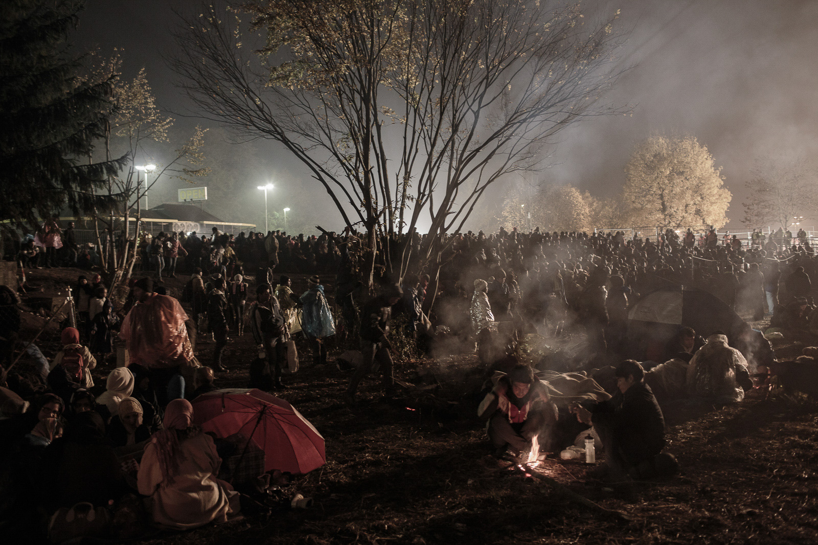Šentilj, Slovenia - October 29, 2015: Refugees burn campfires as night gets cold while they wait to cross the border with Austria in Šentilj, Slovenia on October 29, 2015.