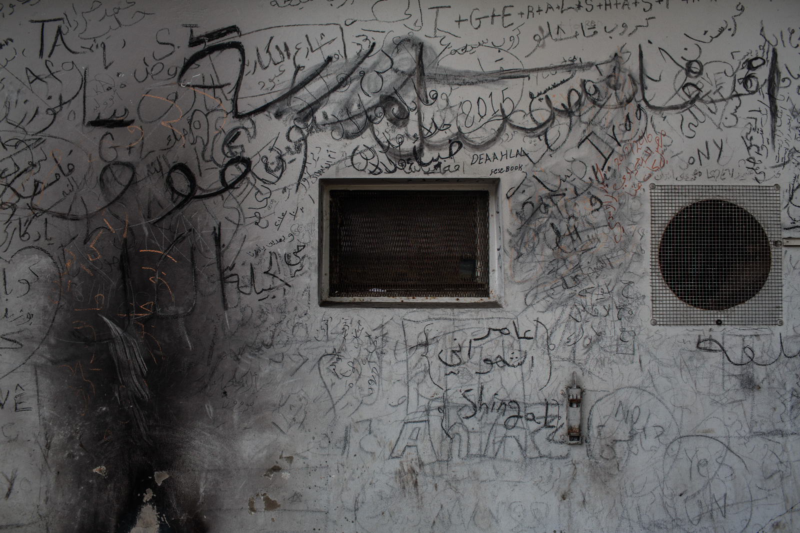 Šentilj, Slovenia - March 1, 2016: Writings on the wall in the migration center, left behind by the last of the refugees and migrants who managed to cross into Austria before the Balkan routed closed and open borders policies changed.