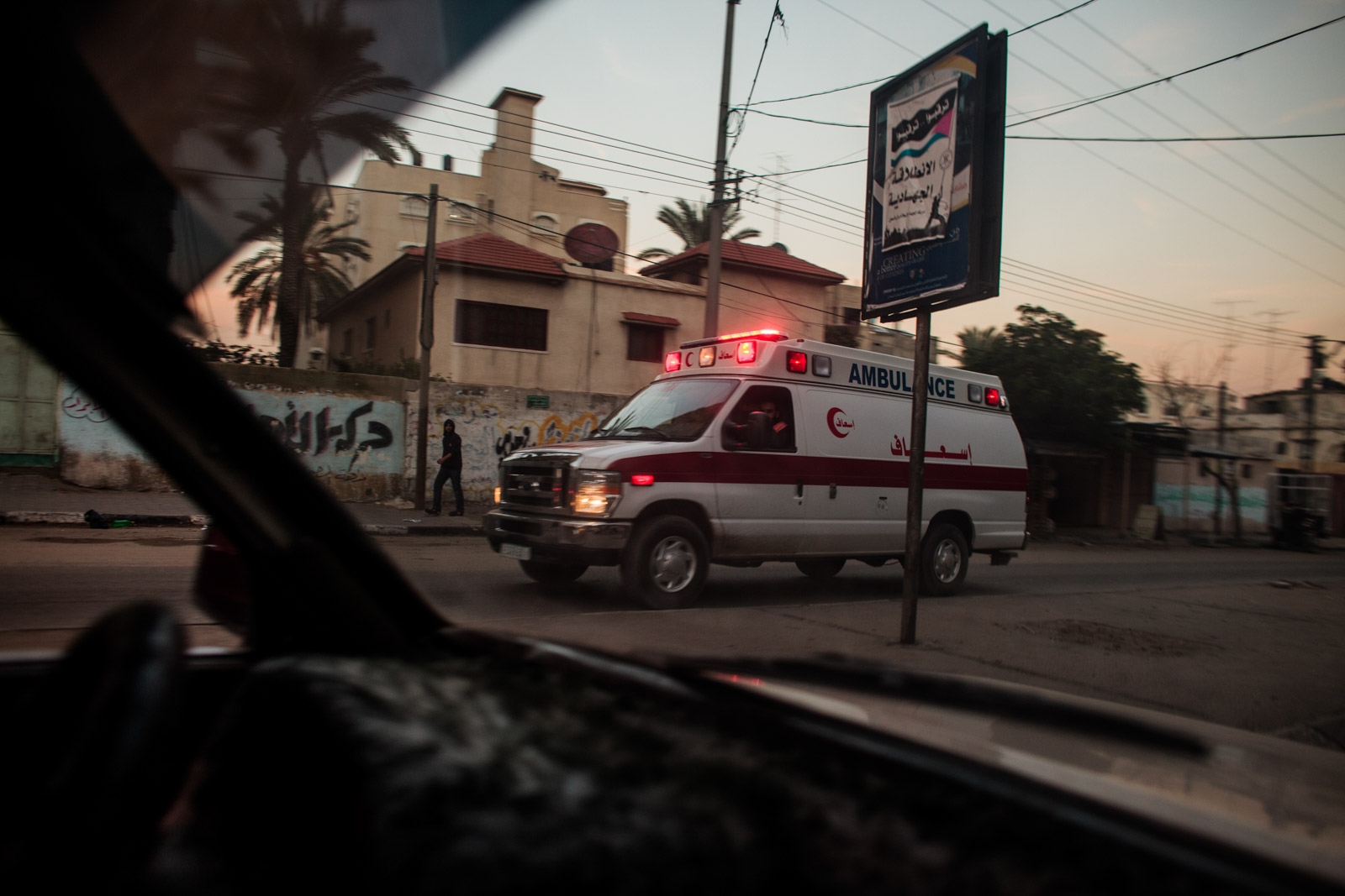 Gaza City, Gaza - November 14, 2012: Palestinian ambulance rushes to the area bombed on the first day of the Israeli military operation dubbed Pillars of Cloud. The 30 air strikes by Israeli air force throughout Gaza strip resulted in the death of 8 people and injured more than 50 only on the first day of the 8-day war.