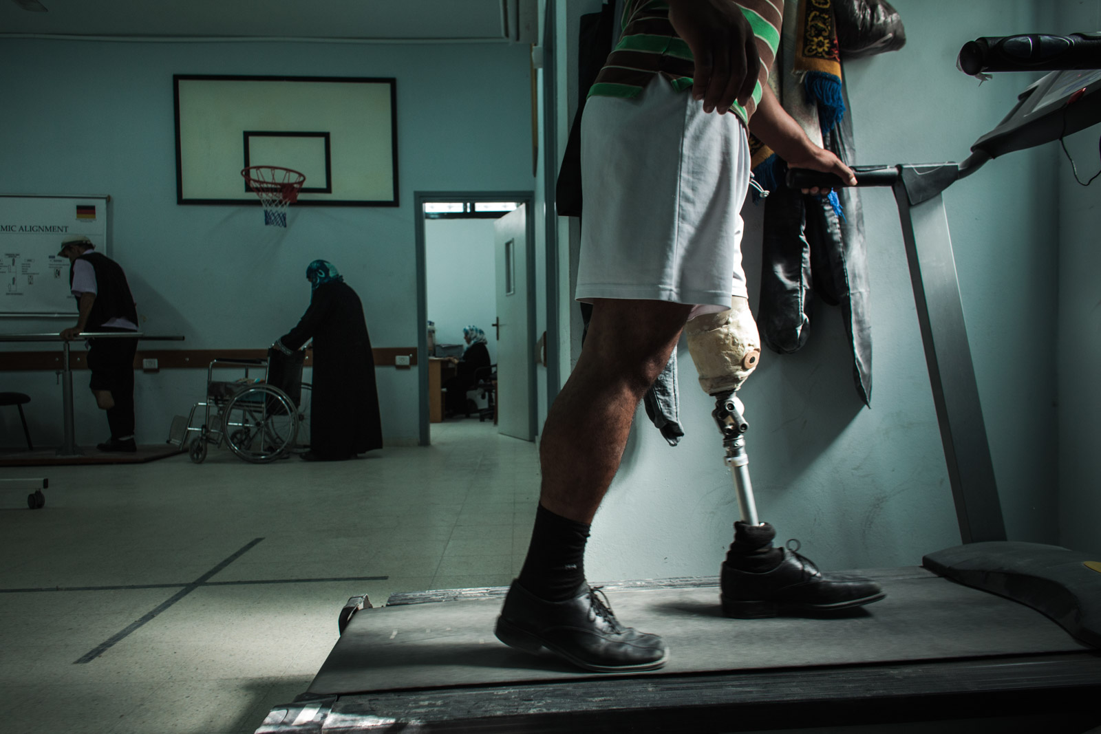 Gaza City, Gaza - November 6, 2012: A patient practices walking with a prosthesis in Gaza Artificial Limbs and Polio Centre. Program of dynamic rehabilitation includes lessons of proper walk and teaches patients how to adjust prosthesis for patient's needs.